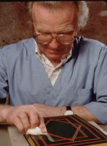 Bill Anthony working on a decorated book cover