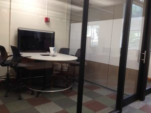 Pod 1 near completion in 2014 with video screen, rounded table and whiteboard.