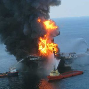 The Deepwater Horizon drilling rig on fire off the coast of Louisiana. Several fire boats are attempting to battle the flames.