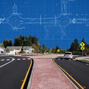 Urban road with blueprints superimposed on the blue sky.