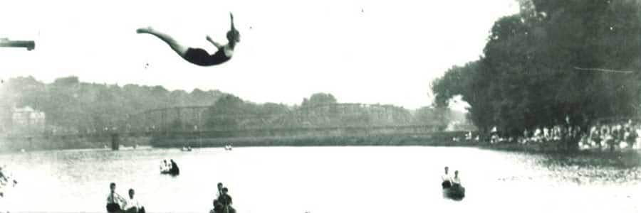 Black and white photograph of Milred Wirt Benson in mid-dive. Iowa River, Iowa City, IA, 1925.