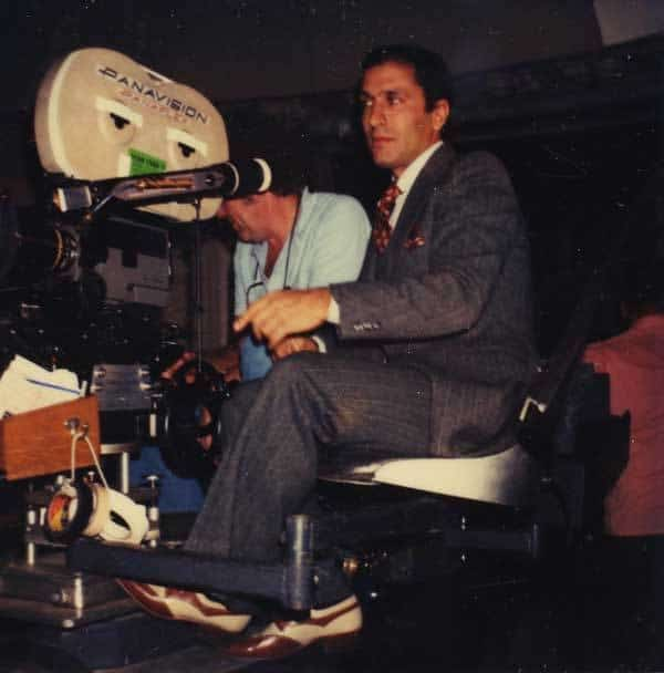Nick Meyer, sitting behind a camera, filming on the set of Star Trek II.