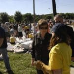 University President Sally Mason talks with sandbagging volunteers, 2008