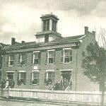 Exterior photo of the Mechanic's Academy, 1870.