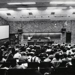 Students packed into large lecture hall, 1985.