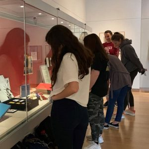 Plan your visit to the Main Library Gallery - pictured: Students viewing the Gallery