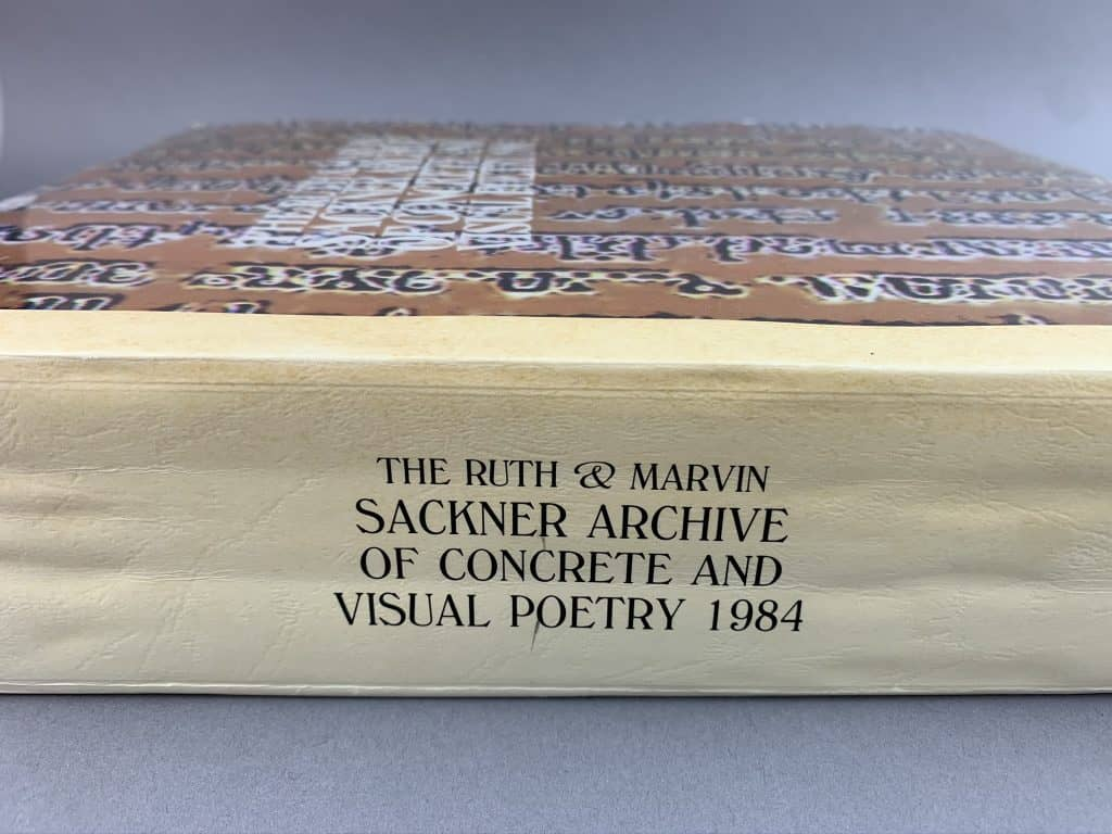 The Sackner Archive catalog of objects is roughly 3 inches thick. This photo shows the 3 inch height of the spine while the book lays flat.