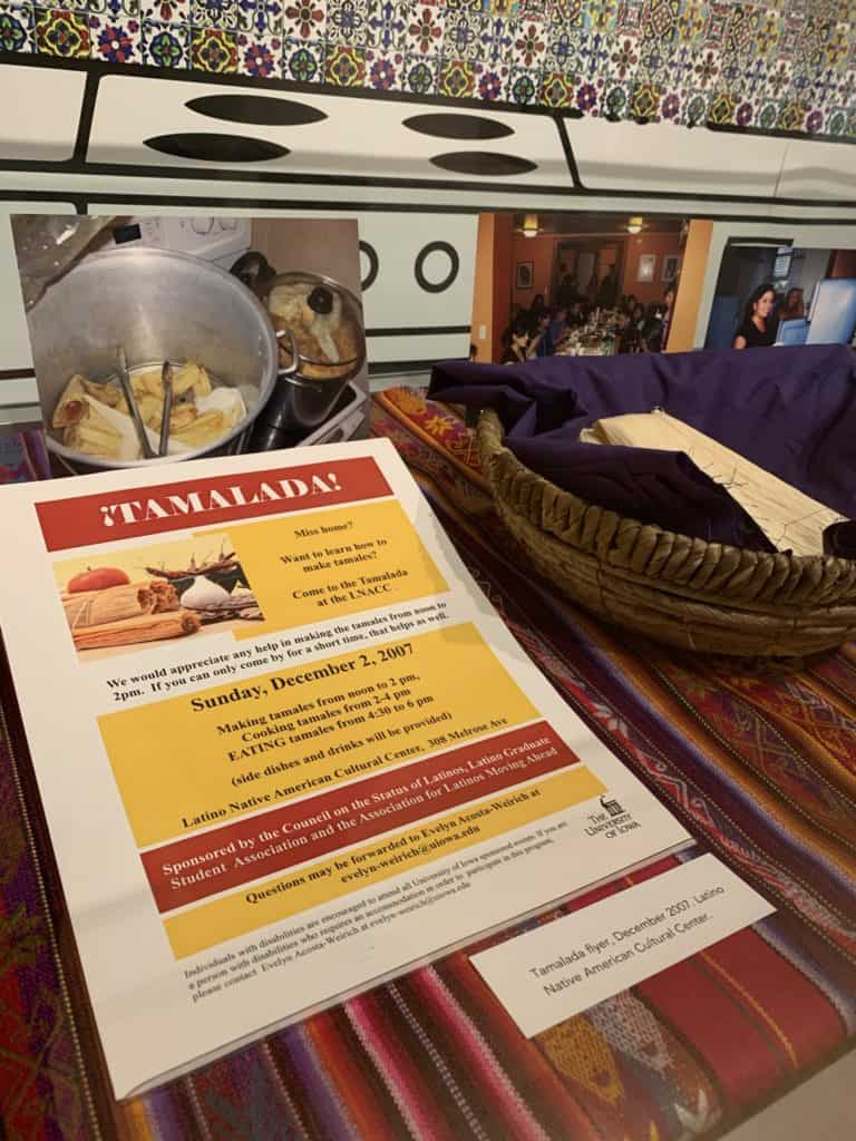 A flyer for a tamale making event and a photo of a pot of tamales on a stove. Faux tamales are in a basket nearby,