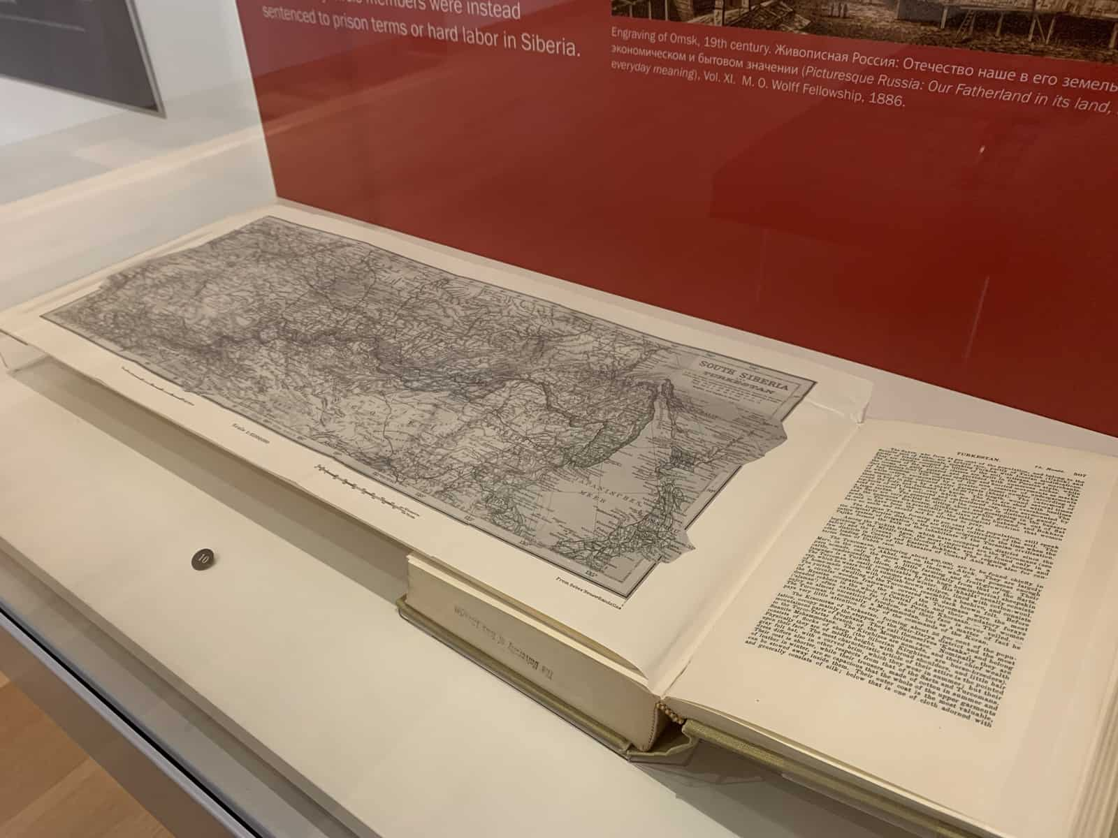 A long illustrated map of Siberia is unfolded from this book and seen in its entirety.