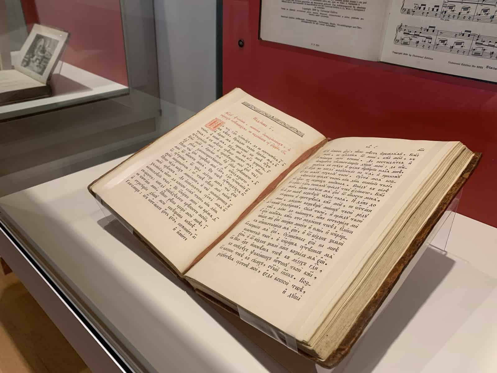 This 19th century book of Psalms is printed in kirillitsa, which is a traditional Russian script that mimics the earliest Russian writing and Church Slavonic of much earlier writings. The book is open, displaying full pages of Russian script.