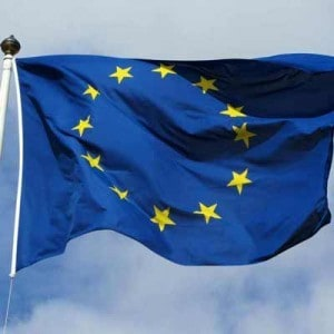 Flag of the European Union (circle of gold stars on a blue background).