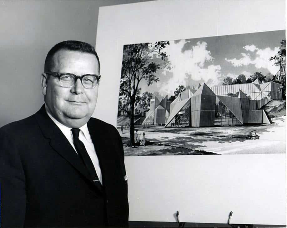 Dean, Robert Hardin shown with a painting of the soon-to-be-built library.