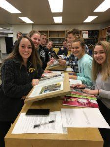 Rhetoric students examine materials in the Perch.