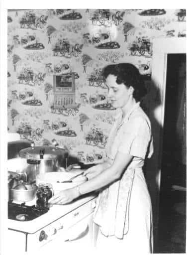 Evelyn Birkby canning on her stove, Shenandoah, Iowa, 1950s