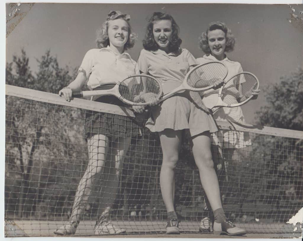 Three women playing tennis