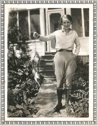 Showing off the day's catch after fishing with Asa Wirt, 1930s