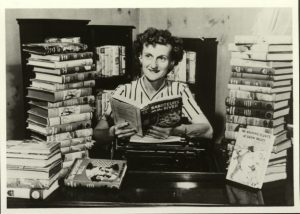 Mildred Wirt poses with her books, 1949. Image taken by The Toledo Blade.