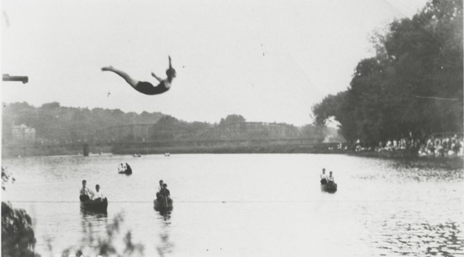 Photo of Mildred diving, arms outstretched, into the Iowa River, ca 1920s.