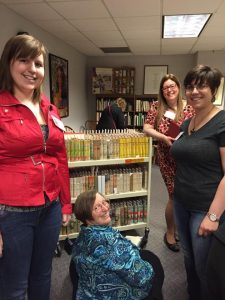 Sleuth members explore Benson's books at the Iowa Women's Archives, 2015.