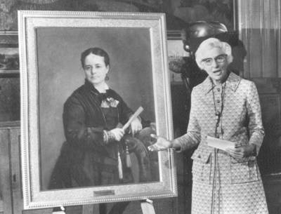 Louise Noun with portrait of Annie Savery.