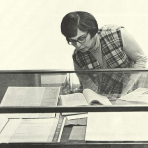 image of rita benton organizing an exhibit