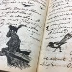 Image of a handwritten diary with a drawing of a cat