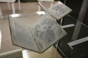 Open book on display from Jay N. Darling Papers