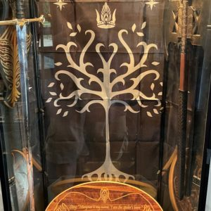 Image of Lord of the Rings swords, banner, and plaque on display