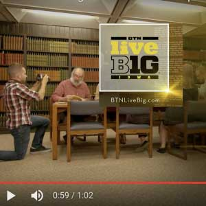 Image of UI Libraries staff in Special Collections, with the Big Ten Network logo